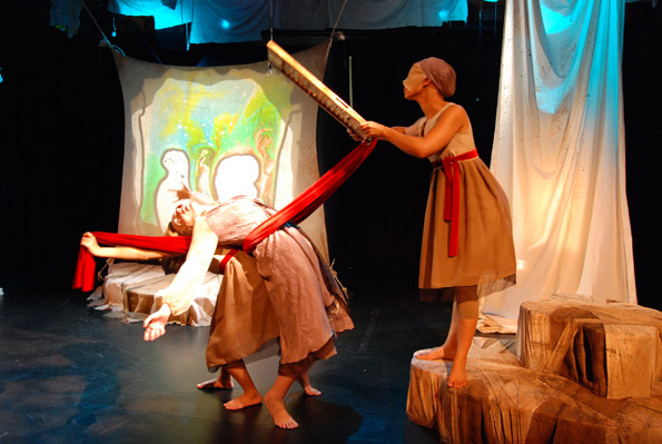 Photo of Nina J. Silver bending backwards with red velvet fabric and the window puppet over her.